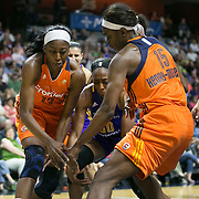 UNCASVILLE, CONNECTICUT- MAY 26:  Sister Nneka Ogwumike #30 of the Los Angeles Sparks and Chiney Ogwumike #13 of the Connecticut Sun challenge for the ball with Aneika Henry-Morello #15 of the Connecticut Sun during the Los Angeles Sparks Vs Connecticut Sun, WNBA regular season game at Mohegan Sun Arena on May 26, 2016 in Uncasville, Connecticut. (Photo by Tim Clayton/Corbis via Getty Images)