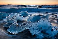Icebergs on the black sand beach at Jökulsárlón Glacier Lagoon, Southeast Iceland.