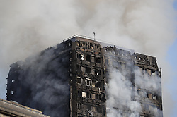 © Licensed to London News Pictures. 14/06/2017. London, UK. The scene of a huge fire at a tower block in White City, London. The blaze engulfed the 27-storey building with 200 firefighters attending the scene. Photo credit: Peter Macdiarmid/LNP