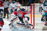 KELOWNA, CANADA - MARCH 8: Evan Sarthou #31 of the Tri City Americans defends the net against the Kelowna Rockets during third period on March 8, 2014 at Prospera Place in Kelowna, British Columbia, Canada.   (Photo by Marissa Baecker/Getty Images)  *** Local Caption *** Evan Sarthou;