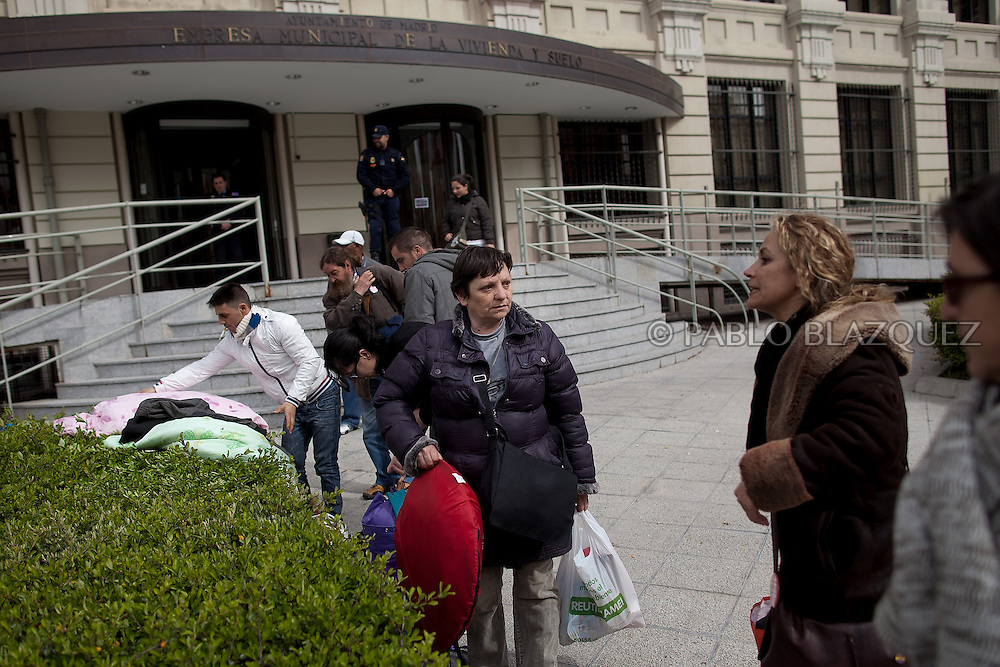 Amalia Torres 51, (C) carries her belongings one day before her eviction takes place outside the Madrid's Council Housing Office where she spent the night claiming to stop her eviction on April 3, 2013 in Madrid, Spain. The Mortgage Holders Platform (PAH) and other anti evictions organizations are organizing 'escraches' since several weeks ago outside Popular Party deputies houses and offices to demand the vote for a Popular Legistative Initiative (ILP) to stop evictions, regulate dation in payment and social rent.