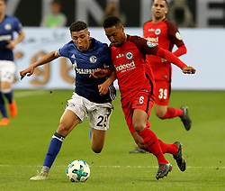 GELSENKIRCHEN, April 19, 2018  Jonathan de Guzman (R) of Eintracht Frankfurt and Amine Harit of Schalke 04 vie for the ball during the German DFB Pokal match between Schalke 04 and Eintracht Frankfurt at the Veltins Arena in Gelsenkirchen Germany, on April 18, 2018. (Credit Image: © Joachim Bywaletz/Xinhua via ZUMA Wire)