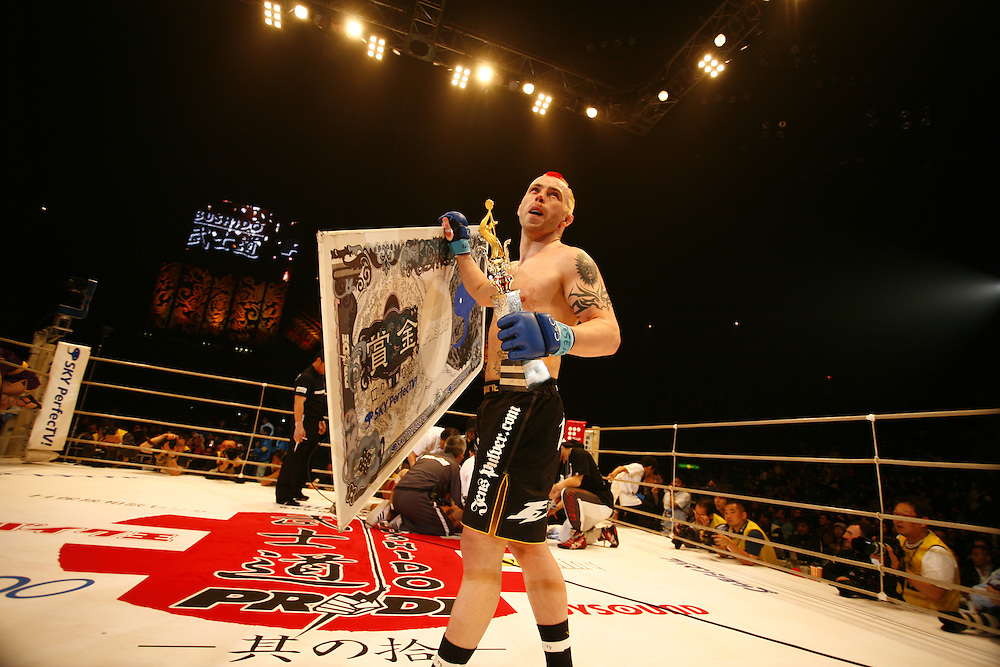 Jens Pulver (usa) Defeats Kenji Arai in  a TKO..BUSHIDO Extreme Martial Art fighting Rules are quite limited and fights usually carry on past the bloody nose stage.  It's  very popular in Japan, goes out on primetime TV, fighters get paid as much as 4 million US Dollars a fight and are seen as celebs. Crowd consist of young families, couples etc. Piece will look at why sport is so successful in Japan, appealing to so called 'lost generation' of young people suffering from effects of collapse of economy/rise of unemployment.