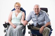 Disabled couple smiling and holding hands with one another,