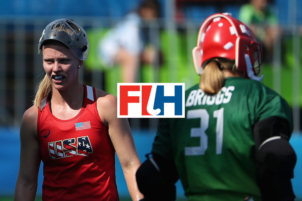 RIO DE JANEIRO, BRAZIL - AUGUST 15:  Stefanie Fee #2 (L) of United States walks past goalkeeper Jackie Briggs #31 during the quarter final hockey game against Germany on Day 10 of the Rio 2016 Olympic Games at the Olympic Hockey Centre on August 15, 2016 in Rio de Janeiro, Brazil.  (Photo by Christian Petersen/Getty Images)