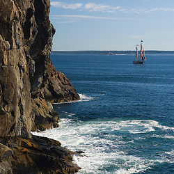 The windjammer Angelique comes around the cliffs of Great Head in Maine's Acadia National Park.  Frenchman Bay.