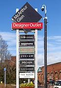McArthur Glen designer outlet sign listing some of the shops, Swindon, Wiltshire, England, UK