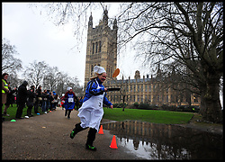 Cathy Jamieson Labour take part in the MP's and Lords race against political Journalist in the Rehab Parliamentary Pancake Shrove Tuesday race a charity event which sees MPs and Lords joined by media types in a race to the finish. Victoria Tower Gardens, Westminster, Tuesday February 12, 2013. Photo By Andrew Parsons / i-Images