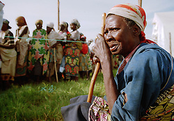 Hundreds of internally displaced people in Angola, wait in line to be analyzed by aid workers in the town of Kuito March, 2000. Angola's brutal 26 year-civil has displaced around two million people - about a sixth of the population - and 200 die each day according to United Nations estimates..(Photo by Ami Vitale)