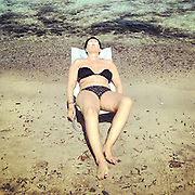 Stintino 2015: woman sunbathing.