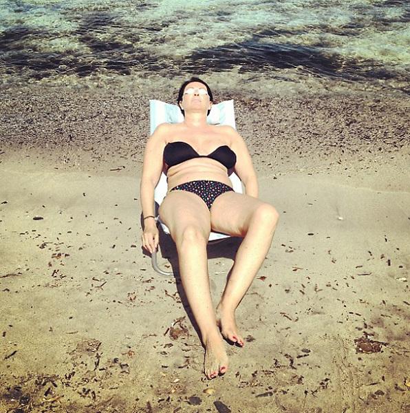 Stintino 2015: woman sunbathing.