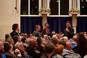Dietzenbach   09 October 2015<br /> <br /> Am Freitag (09.10.2015) f&uuml;hrte die Partei &quot;Alternative f&uuml;r Deutschland&quot; (AfD) im B&uuml;rgerhaus in der hessischen Kleinstadt Dietzenbach eine Veranstaltung unter dem Motto &quot;Internationale Politik und Asylchaos&quot; durch, Hauptredner war Dr. Alexander Gauland.<br /> Hier: Zum Ende der Veranstaltung erheben sich drei Aktivisten und tragen vor, was sie &uuml;ber die teilweise hemmungslos rassistischen Reden und Diskussionsbeitr&auml;ge denken. Der AfD-Funktion&auml;r Dr. Robert Rankl (r, mit Mikrofon) versucht, f&uuml;r einen Fortgang des Abends im Sinne der Veranstalter zu sorgen.<br /> <br /> &copy;peter-juelich.com<br /> <br /> [No Model Release   No Property Release]