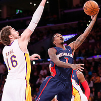 17 November 2013: Detroit Pistons point guard Brandon Jennings (7) goes for the layup past Los Angeles Lakers center Pau Gasol (16) during the Los Angeles Lakers 114-99 victory over the Detroit Pistons at the Staples Center, Los Angeles, California, USA.