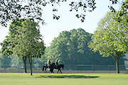 © Licensed to London News Pictures. 15/05/2014. Windsor, UK. People exercise their horses in the early morning sunshine. The second day of The Royal Windsor Horse Show, set in the grounds of Windsor Castle. Established in 1943. Photo credit : Stephen Simpson/LNP