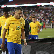 FOXBOROUGH, MASSACHUSETTS - JUNE 12:  Renato Augusto #18 of Brazil and other players leave the field after their 1-0 loss during the Brazil Vs Peru Group B match of the Copa America Centenario USA 2016 Tournament at Gillette Stadium on June 12, 2016 in Foxborough, Massachusetts. (Photo by Tim Clayton/Corbis via Getty Images)