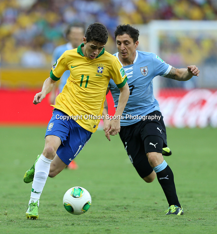 26th June 2013 - FIFA Confederations Cup 2013 (Semi-Final) - Brazil v Uruguay - Oscar of Brazil battles with Cristian Rodriguez of Uruguay - Photo: Simon Stacpoole / Offside.