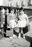 two little girls holding hand ready to go to school France ca 1950s