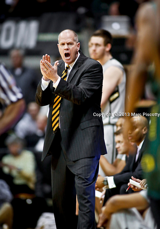SHOT 3/7/13 8:16:35 PM - Colorado head basketball coach Tad Boyle encourages his team from the sidelines during a game against  Oregon at the Coors Events Center on the University of Colorado campus in Boulder, Co. Colorado won the game 76-53..(Photo by Marc Piscotty / © 2013)