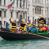 VENICE, ITALY - FEBRUARY 20:  Members of the Arzana' association dressed as flowers and bees raw along the Grand Canal during the Venetian Feast on February 20, 2011 in Venice, Italy. During the Venetian Feast a traditional water parade sails from San Marco along the Canal Grande to the  district of Cannaregio where there the crowd waits for the Svolo della Pantegana  (flight of the mouse).