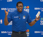 Former NBA player Felipe Lopez talks with students during a financial education and success program sponsored by NBA Cares and BBVA Compass at Crespo Elementary School, February 27, 2014.