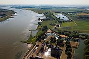 Nederland, Gelderland, Gemeente Zaltbommel, 08-07-2010; Poederoijen Slot Loevestein met links de Waal. Op het middenplan de Buitenpolder Het Munnikeland. De Waalkade (links) zal verlaagd worden in het kader van van het programma Ruimte voor de Rivier, de polderzal in de toekomst weer als komgebied gebruikt kunnen gaan worden voor de opvang van water bij hoge waterstanden. Kasteel Loevestein maakt deel uit van de Hollandse Waterlinie..Loevestein castle and river Waal,  part of the defense line Holland Waterline..Under the program 'space for the river', there are plans to use the polder (top) as retaining basin during high water. .luchtfoto (toeslag), aerial photo (additional fee required).foto/photo Siebe Swart.