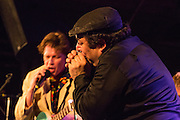 "Harmonica player ""Shaky"" Dave Pollack with Alex Battles."