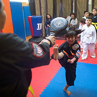 Kimberly Rivera practices her front kick at a Karate Class in Gallup taught by Dylan Vargas.