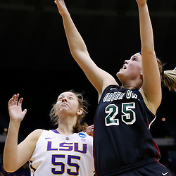 Mar 24, 2013; Baton Rouge, LA, USA; Green Bay Phoenix forward Jenny Gilbertson (25) shoots over LSU Tigers forward Theresa Plaisance (55) in the second half of the first round of the 2013 NCAA womens basketball tournament at the Pete Maravich Assembly Center.  LSU defeated Green Bay 75-71. Mandatory Credit: Derick E. Hingle-USA TODAY Sports