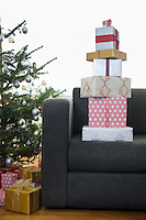 Stack of Christmas presents on armchair