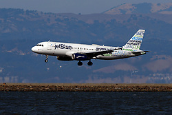 Airbus A320-232 (N598JB) operated by JetBlue Airways with the Inspiring Humanity livery landing at San Francisco International Airport (KSFO), San Francisco, California, United States of America