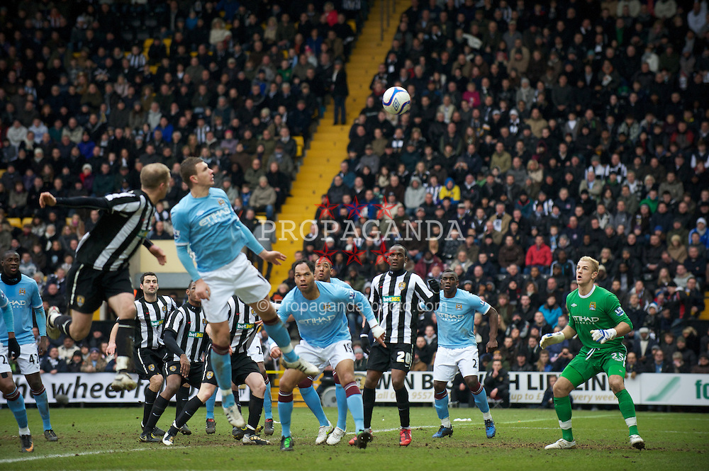 NOTTINGHAM, ENGLAND - Sunday, January 30, 2011: Notts County's Neal Bishop scores the first goal against Manchester City during the FA Cup 4th Round match at Meadow Lane. (Photo by David Rawcliffe/Propaganda)