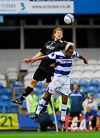 Photo: Leigh Quinnell.<br /> Queens Park Rangers v Cardiff City. Coca Cola Championship. 18/08/2007. Cardiffs Glenn Loovens rises above QPRs Dexter Blackstock.