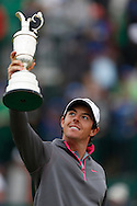 Rory McIlroy after winning with the trophy<br /> wins on the the 18th hole<br /> on the final day at the The Open Championship, Royal Liverpool, Hoylake,  July 2014 <br /> Picture Credit:  Mark Newcombe / visionsingolf.com