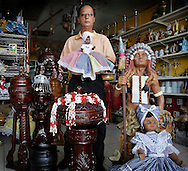 Ernesto Pichardo, a santeria religious oba priest, stands amongst many items used in Santeria and spirtualism. Many items sold at the Botanica Viejo Lazaro at 5830 West Flagler St. are sent to Cuba by followers of the religion. AL DIAZ / MIAMI HERALD