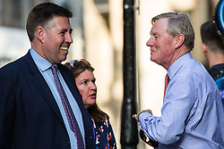 London, UK. 23 July, 2019. Sir Graham Brady (l), Chairman of the 1922 Committee, arrives to attend a celebration in Westminster of Boris Johnson's election as Conservative Party leader and replacement of Theresa May as Prime Minister organised by the pro-Brexit European Research Group (ERG).