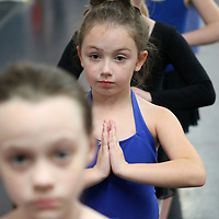 "Ashlyn Clark, 8, of Tupelo, lines up for the next dance routine during practice for ""Hope for the Holidays"" at the North Mississippi Dance Centre. The annual dance is a fundraiser for St. Jude."