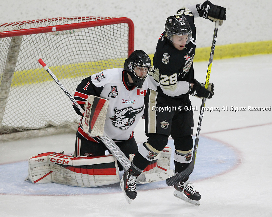 GEORGETOWN, ON  - APR 18,  2017: Ontario Junior Hockey League, Championship Series. Georgetown Raiders vs the Trenton Golden Hawks in Game 3 of the Buckland Cup Final. Lucas Brown #28 of the Trenton Golden Hawks deflects the shot during the first period.<br /> (Photo by Tim Bates / OJHL Images)
