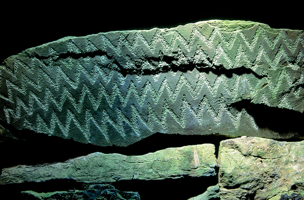 Fourknocks prehistoric site, County Meath, Ireland. Chevron carved pattern on stone inside megalithic burial chamber No. 1.