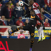 Mar 19, 2016; Harrison, NJ, USA; Houston Dynamo midfielder Oscar Garcia (27) and New York Red Bulls d Ronald Zubar (23) go for a head ball in the first half at Red Bull Arena. Mandatory Credit: William Hauser-USA TODAY Sports