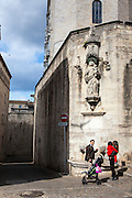 Couple with child outside the Cathedral of Saint Mary of Girona, Catalonia, Spain. (c) 20014 Dave Walsh