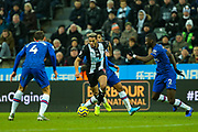 Joelinton (#9) of Newcastle United on the ball under pressure from Antonio Rudiger (#2) of Chelsea and Andreas Christensen (#4) of Chelsea during the Premier League match between Newcastle United and Chelsea at St. James's Park, Newcastle, England on 18 January 2020.