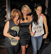 29.APRIL.2010. LONDON<br /> <br /> A WORSE FOR WEAR LOOKING SARAH HARDING AND CLAIRE MERRY LEAVING KANALOA NIGHTCLUB AT 3.30AM IN ST.PAUL'S HOLDING A BOTTLE OF BISMOL WHICH PROVIDES FAST RELEIF FOR AN UPSET STOMACH, DIARREAH AND INDIGESTION. SARAH THEN WENT TO MAHIKI TO PICK UP BOYFRIEND TOM CRANE.<br /> <br /> BYLINE: EDBIMAGEARCHIVE.COM<br /> <br /> *THIS IMAGE IS STRICTLY FOR UK NEWSPAPERS AND MAGAZINES ONLY*<br /> *FOR WORLD WIDE SALES AND WEB USE PLEASE CONTACT EDBIMAGEARCHIVE - 0208 954 5968*