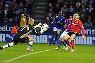 Leicester city keeper Kasper Schmeichel saves from Cardiff's Craig Conway. NPower championship, Leicester city v Cardiff city at the King Power stadium in Leicester on Saturday 22nd Dec 2012. pic by Andrew Orchard, Andrew Orchard sports photography,