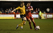 Lyle Della-Verde and Mark Byrne challenge for the ball during the Sky Bet League 2 match between Crawley Town and Newport County at the Checkatrade.com Stadium, Crawley, England on 1 March 2016. Photo by Michael Hulf.