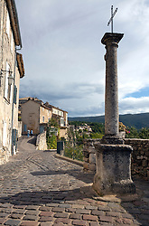 Town buildings, many of which date from the Middle Ages, tilt here and there in Menerbes in the Luberon area of Provence, southern France.