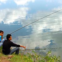 Turkish fishermen fishing in lake in Turkey