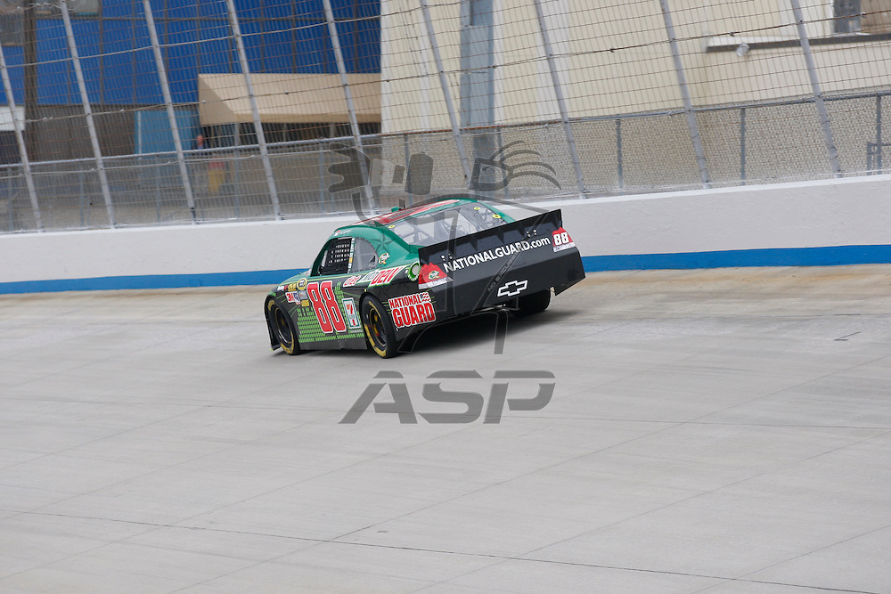 DOVER, DE - JUN 01, 2012:  Dale Earnhardt, Jr. (88) brings his Amp Chevrolet on the track for a practice session for the FedEx 400 Benefiting Autism Speaks at the Dover International Speedway in Dover, DE.