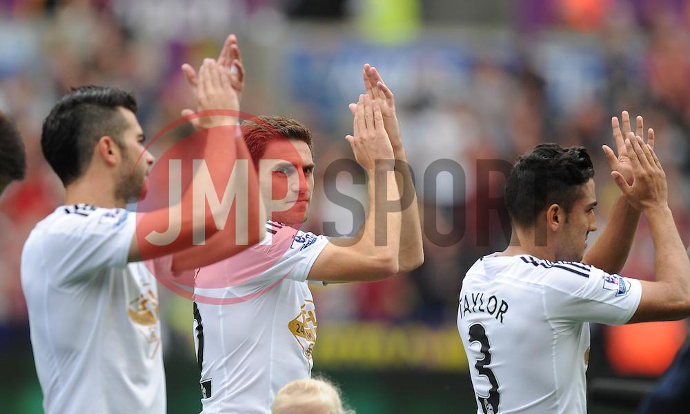 Swansea City's Angel Rangel claps the home fans prior to making his 100th Premier League appearance  - Photo mandatory by-line: Alex James/JMP - Mobile: 07966 386802 30/08/2014 - SPORT - FOOTBALL - Swansea - Liberty Stadium - Swansea City v West Brom - Barclays Premier League