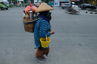 North Sumatra, Indonesia, April 02, 2020: A trader of Indonesian  traditional medicine 'Jamu', Rakinem, 53, seen using mask while working in the main street of Medan, Indonesia on April 02, 2020.  Jamu is herbs made from spices to increas human endurance during Corona Virus Disease-19 crisis.