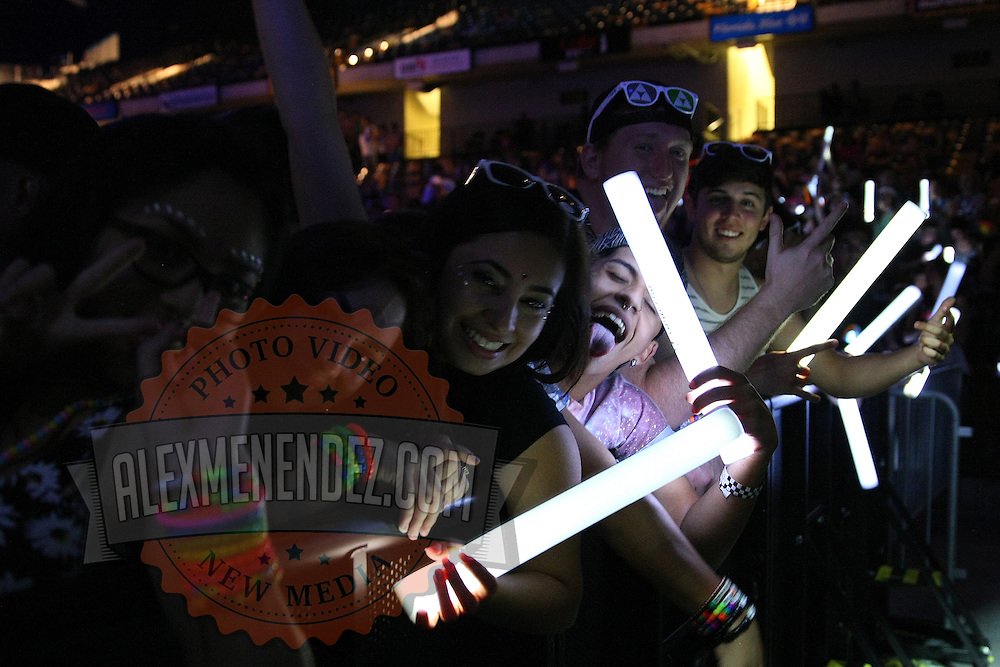 Fans line the front row during the Verge Campus Spring Tour concert at the CFE Arena on the University of Central Florida campus, Tuesday, April 8, 2014, in Orlando, Florida.  (AP Photo/Alex Menendez)